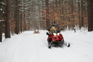 "Snowmobiling at White Lake State Park on 12/17/13"".  Courtesy NH Division of Parks & Recreation/Grant Klene."